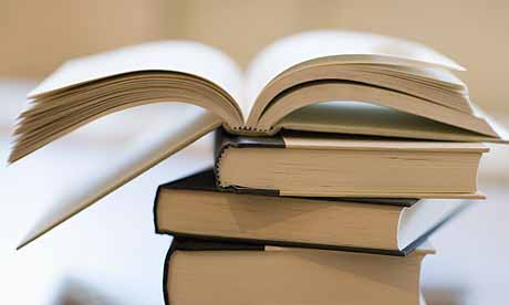 Open book on stack of closed books
